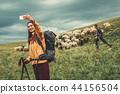 female backpacker hiking 44156504