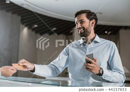 Optimistic man is giving business card to woman 44157653