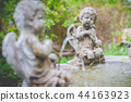Statue of a beautiful little angle in the garden 44163923