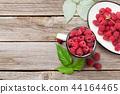 Cup of ripe raspberries 44164465