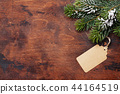 Christmas fir tree over wooden backdrop 44164519