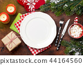 Christmas table setting with candles and xmas gift 44164560