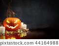Composition of pumpkin and candles 44164988