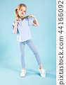 Full-length portrait of a beautiful girl in blue clothes on a blue background. 44166092