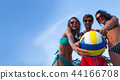 Friends playing volleyball 44166708
