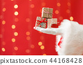 Santa holding small Christmas gift boxes 44168428