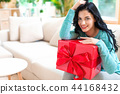 Young woman with a gift box 44168432