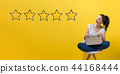 Five star rating with woman using a laptop 44168444