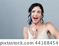 Young woman holding a toothbrush 44168454
