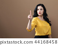 Young business woman pointing something 44168458