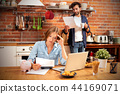 Young couple in savings and home budget concept 44169071