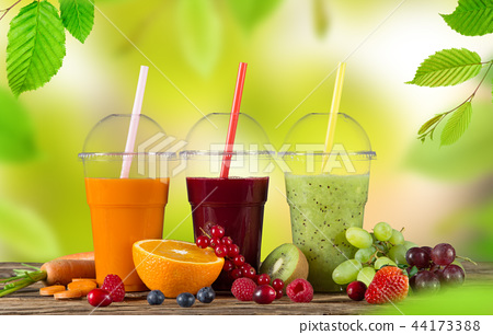 Fresh juice mix fruit, healthy drinks on wooden table. 44173388