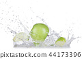 Fresh apples with water splash over white background. 44173396
