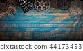 Cinema concept of vintage film reels, clapperboard and projector. 44173453