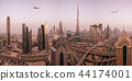 Commercial airplane flying above modern city. 44174001