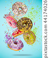 Tasty doughnuts in motion falling on pastel blue background. 44174026