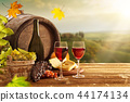 Delicious cheeses and wine on old wooden table. 44174134