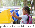 asian girl throw plastic glass in recycling trash 44177519