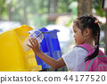 asian girl throw plastic glass in recycling trash 44177520