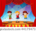 Group of children perform on stage 44179473