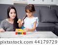 Mother and child play toy together 44179729