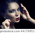 beauty brunette woman under black veil with red manicure close u 44179951