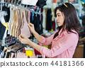 woman choosing and buying bra in shopping store 44181366