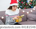 Asian woman upset when open gold xmas gift box 44181546