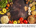 Vegan food ingredients on a dark background.  44182002