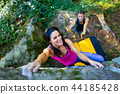 Happy girl practicing bouldering  44185428