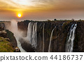 Victoria falls dreamy sunset panorama with orange 44186737