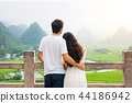 Couple enjoying Karst mountain view together 44186942
