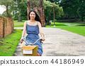 Girl exploring Ayutthaya on bicycle 44186949