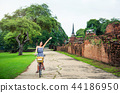 Girl exploring Ayutthaya on bicycle 44186950