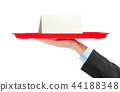 Hand and tray with paper card 44188348