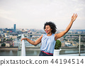 A portrait of businesswoman standing against London rooftop view panorama. 44194514