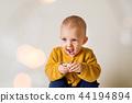 A portrait of a cute toddler boy. 44194894