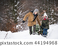 Grandfather and small girl getting a Christmas tree in forest. 44194968