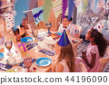 Positive children singing while being at birthday party 44196090