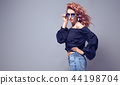 Adorable Redhead woman in Studio. Trendy Outfit 44198704