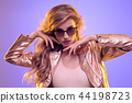 Fashion neon light. Blond Girl, glowing Hairstyle 44198723