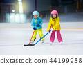 Children play ice hockey. Kids winter sport. 44199988