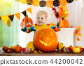 Kids in witch costume on Halloween trick or treat 44200042