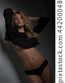 dark portrait blonde slim girl in black panties 44200048