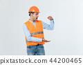 Happy beard engineer holding hand on side and explaining something, guy wearing caro shirt and jeans 44200465