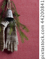 Handgloves and christmas bell 44200841
