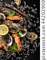 Fresh seafood on crushed ice. 44202909