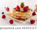 delicious pancakes on wooden table with fruits 44203157