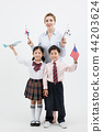 Children education. little boy and girl with native English-speaking teacher in white background 288 44203624