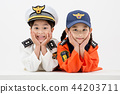 Children education. Young boy and girl wearing police and firefighter uniform in white background 145 44203711